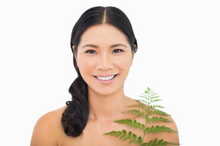 dark haired woman: Pretty dark haired woman with fern on white background