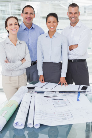 Happy architects posing while working together in bright office photo