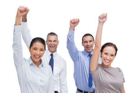 Cheerful work team posing with hands up on white background