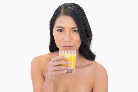 nude model: Sensual nude model having orange juice on white background