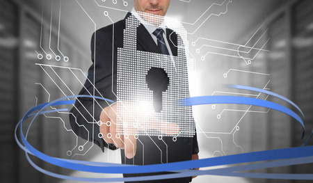 security: Businessman touching lock on futuristic interface with swirling lines in data center