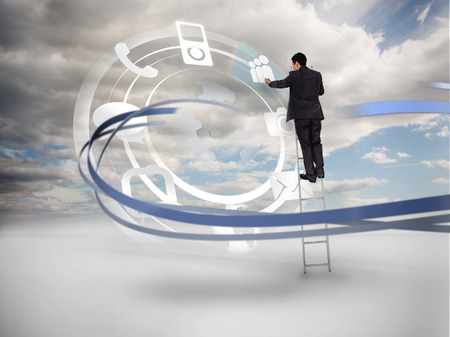 encircling: Businessman on ladder touching wheel interface of applications on cloudy background