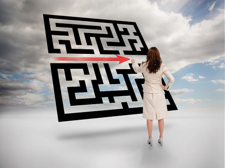 Businesswoman drawing red arrow through qr code on cloudy background