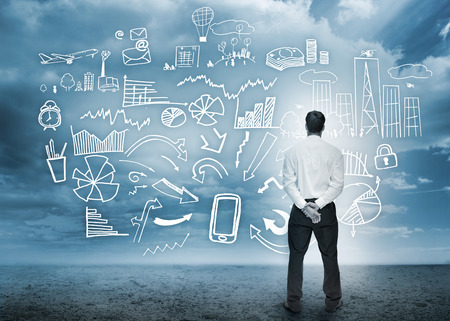 thinking cloud: Businessman standing looking at detailed business flowchart in cloudy storm setting