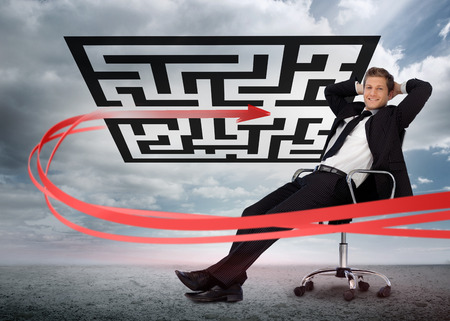 Businessman sitting in front of red arrow through qr code smiling at camera in swivel chair Stock Photo