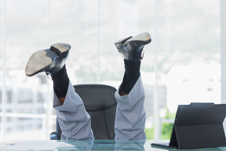 swivel: Business getting crazy falling from his swivel chair in bright office