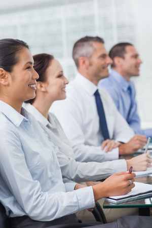 Cheerful workmates attending presentation in bright office Stock Photo - 25765832