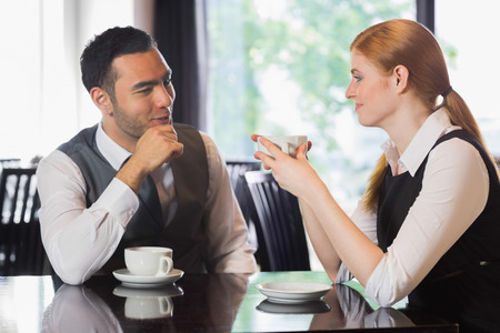 Business people talking over coffee in a cafe photo