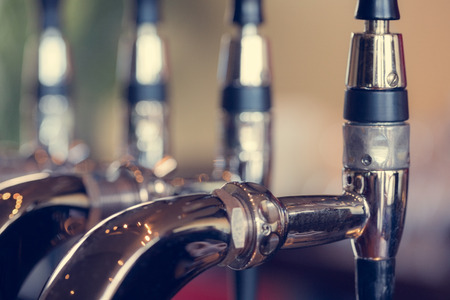 beer pump: Beer taps close up in a pub