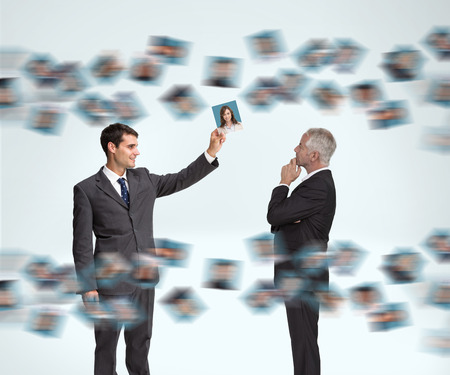 Businessmen working together holding profile picture photo