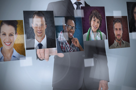 Human Resource: Businessman presenting profile pictures on digital interface
