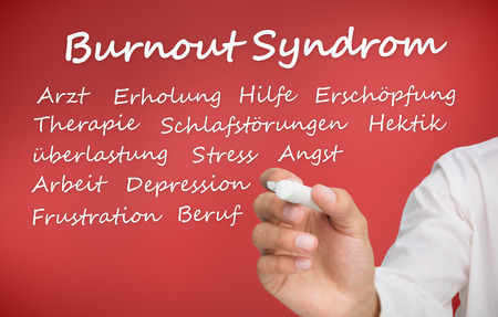 debility: Hand writing different words about burnout syndrome in german on red background