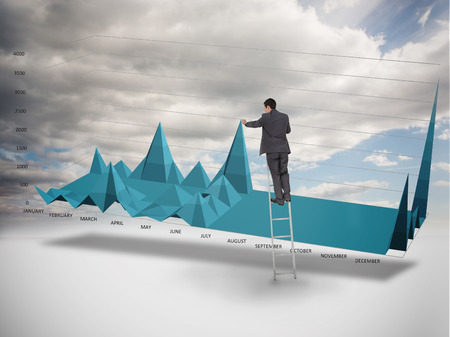 Businessman on a ladder catching the tip of a chart with cloudy sky on the background photo