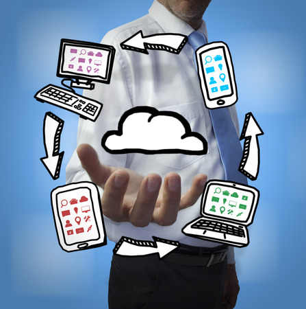 Classy businessman holding cloud computing drawings on blue background photo