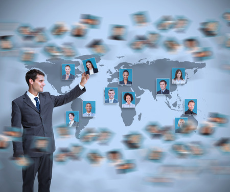 Young businessman holding profile picture on map background photo