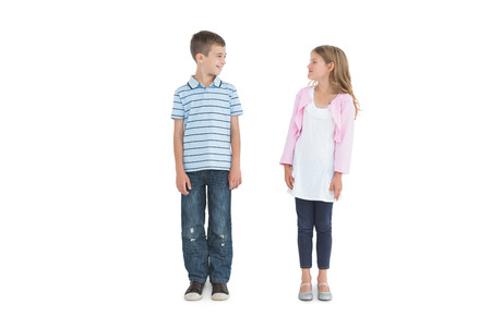 Calm young brother and sister posing on white background Stock Photo