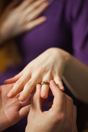 proposed: Moved girlfriend being proposed in a classy restaurant Stock Photo