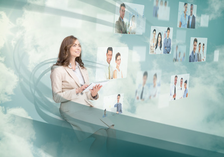 Smiling businesswoman using digital interface while cloud computing photo