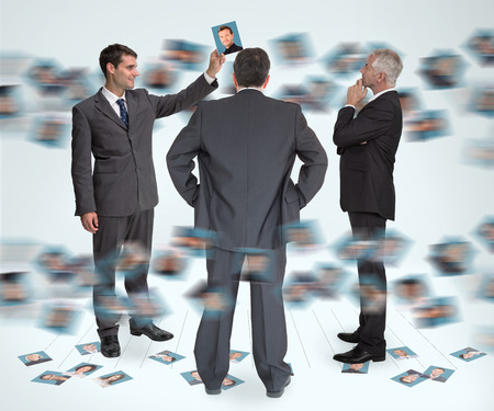 eliminating: Stylish businessmen working together holding profile picture