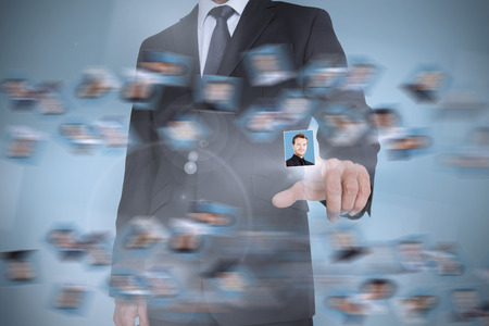 profile picture: Businessman presenting profile picture on digital interface Stock Photo