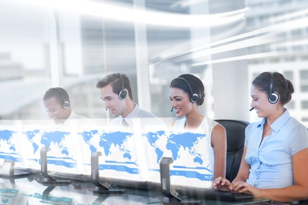 work worker workforce world: Call center employees at work on futuristic holograms in bright modern office Stock Photo