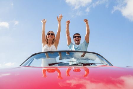 freedom couple: Crazy couple standing in red cabriolet on a sunny day