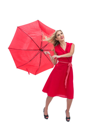 Pretty glamour woman holding a broken umbrella against white background photo