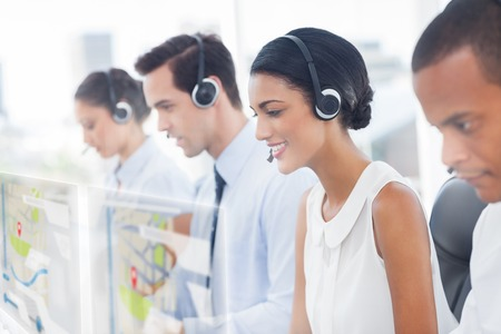 call: Call center employees at work on futuristic hologram interfaces in bright modern office