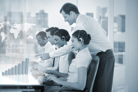 work worker workforce world: Call center employees at work on futuristic holograms showing map and graph with supervisor in office