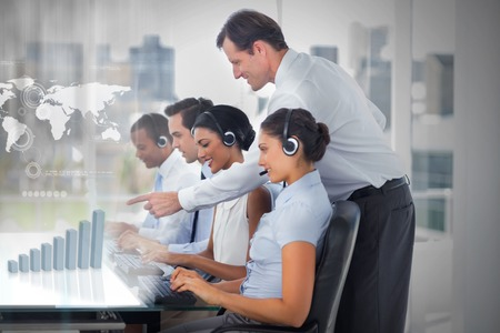 work worker workforce world: Call center employees at work on futuristic interfaces showing map and graph with supervisor in the office