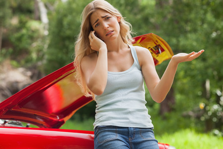 breaking down: Desperate blonde calling for assistance after breaking down with her cabriolet