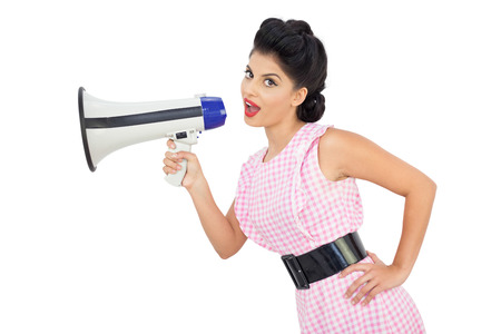 Attractive black hair model using a megaphone on white background photo