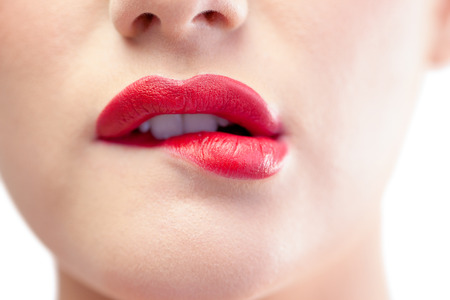 sexual background: Close up on gorgeous model biting red lips on white background Stock Photo