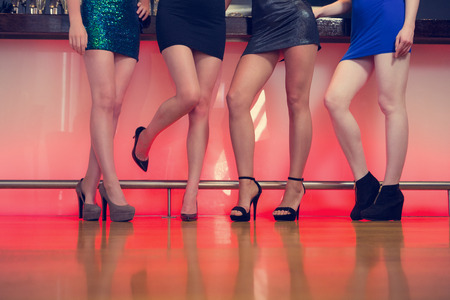 girls night out: Sexy women legs posing at a bar in a nightclub
