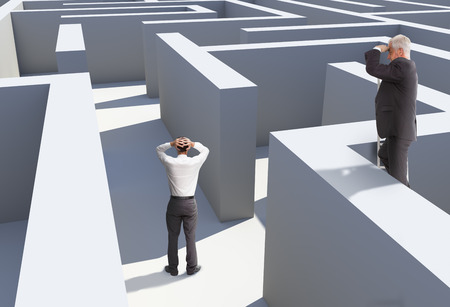 Two businessmen standing in maze being captured photo