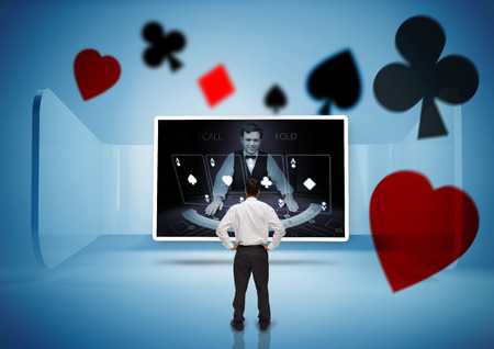Rear view of businessman looking at picture of dealer in blue light photo