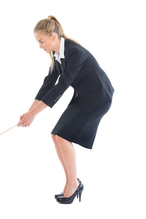 Concentrating young businesswoman pulling a rope on white backgroun photo