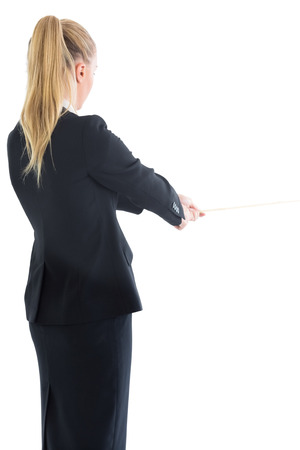 Blonde ponytailed business woman pulling a rope on white background photo