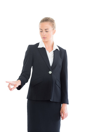 Young business woman pointing on white background photo