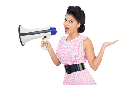 Seductive black hair model using a megaphone on white background photo