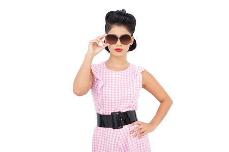 Pretty black hair model wearing sunglasses on white background photo