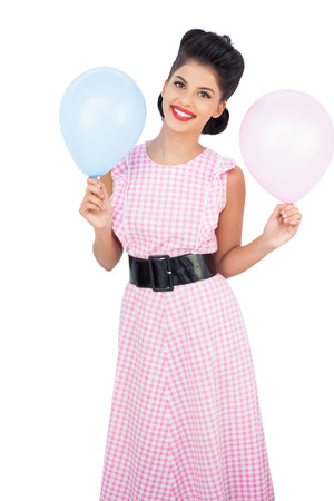 Cheerful black hair model holding balloons on white background photo