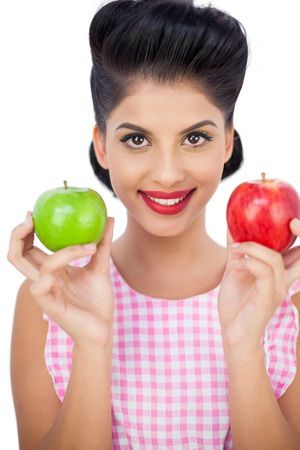Happy black hair woman holding apples on white background photo