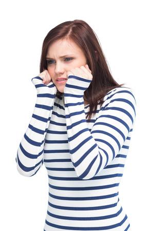 apprehensive: Apprehensive young brunette posing on white background