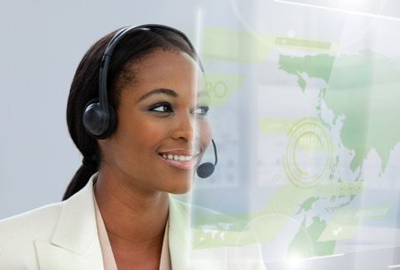 Portrait of an Afro-american businesswoman with headset in the office photo