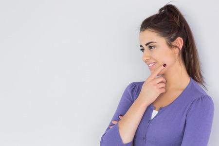 Beautiful thoughtful woman wearing a purple cardigan