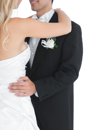 Close up of a married couple dancing viennese waltz on white background photo