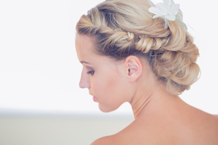 bridal hair: Pretty young bride looking down having chic hairstyle Stock Photo