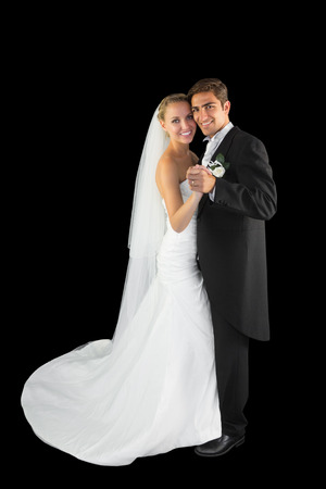 Happy young married couple dancing viennese waltz smiling at camera photo