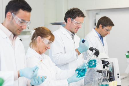 Side view of a group of scientists working in the laboratory photo